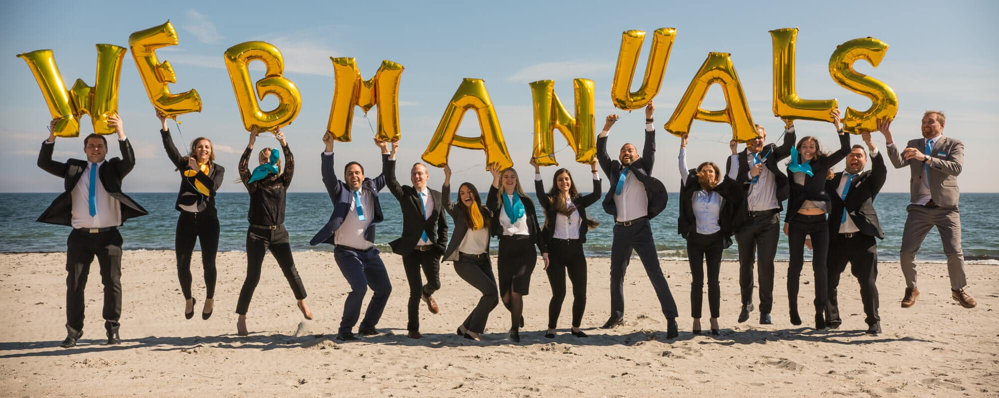 web manuals employees holding letters on the beach